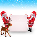 Two santa is holding white sign with deer Stock Photos