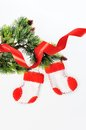 Two santa s boots on christmas tree and red ribbon Royalty Free Stock Image