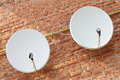 Two satellite dishes Stock Photos