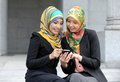 Two scarf girl use smart phone Royalty Free Stock Images