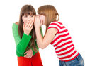 Two school girls whisper Stock Photo