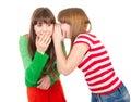 Two school girls whisper Royalty Free Stock Photo