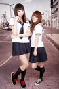 Two schoolgirls outdoors. Royalty Free Stock Photography