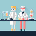 Two scientist chemists in white lab coats in a scientific laboratory. Man and woman make a chemical experiment with