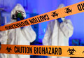 Two scientists in hazardous laboratory. Royalty Free Stock Photo