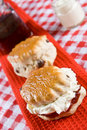 Two scones with clotted cream Royalty Free Stock Photography