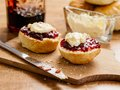 Two scones with clotted cream and jam photo of delicious on a plate Stock Image