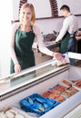 Two sellers of frozen fish Royalty Free Stock Photo