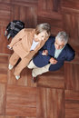 Two senior people with suitcase walking together a Royalty Free Stock Photo