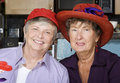 image photo : Two Senior Women Wearing Red Hats