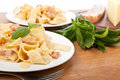 Two servings of homemade pasta carbonara with fresh basil Stock Image