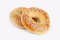 Two sesame bagels on white background Royalty Free Stock Photography