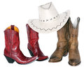 Two sets of boots with cowboy hat Royalty Free Stock Photo