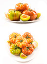 Two sets of compositions of lycopersicum type tomatoes on a white plate