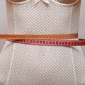 Two sewing centimeters on the womans waist Royalty Free Stock Photo