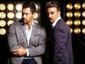 Two sexy handsome fashion male models men dressed in elegant suits Royalty Free Stock Photo