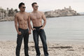 Two sexy males next to the sea Royalty Free Stock Photo