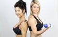 Two sexy sportswomen beautiful muscular women in sportswear Stock Images