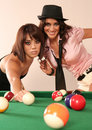 Two sexy woman playing pool Royalty Free Stock Photo