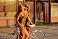 Two sexy women in swimsuits with vintage bike Royalty Free Stock Photos