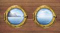 Two ship windows or portholes with sea or ocean tropical island travel and andventure concept Royalty Free Stock Photography