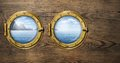 Two ship windows with tropical sea or ocean island Royalty Free Stock Photo