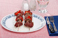 Two shish kabobs on a bed of white rice Royalty Free Stock Photo