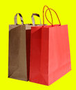 Two shopping bags isolated on yellow background Stock Image