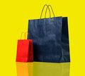 Two shopping bags on yellow Royalty Free Stock Images