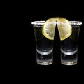 Two shots of tequila with lime and salt Stock Image