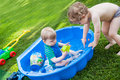 Two sibling boys having fun with water in summer Royalty Free Stock Photography