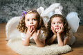 Two sisters with angel wings little in costume Royalty Free Stock Photos