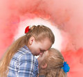 Two sisters embracing and kissing senior junior on abstract background Stock Photo