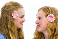 Two sisters looking at each other european teenage girls isolated on white background Royalty Free Stock Photo