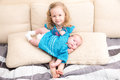 Two sisters. Older sister kid hugging his newborn little sister. Royalty Free Stock Photo
