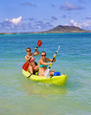 Two sisters paddling a kayak in Hawaii Stock Photography