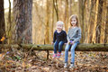 Two sisters picking the first flowers of spring Royalty Free Stock Photo