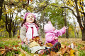 Two sisters play in the park. Stock Photo