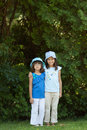 Two sisters a portrait of little girls with the backdrop of lavish greenery Royalty Free Stock Photos
