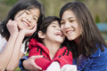 Two sisters and their disabled little brother Royalty Free Stock Photo