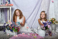 Two sisters in white dresses with flowers Royalty Free Stock Photos
