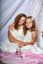 Two sisters in white dresses togewer Royalty Free Stock Photo