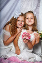 Two sisters in white dresses togewer Royalty Free Stock Photos