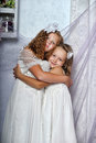 Two sisters in white dresses togewer Stock Photography