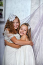 Two sisters in white dresses togewer Royalty Free Stock Images