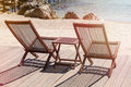 Two sitting place and table in a tropical beach summer vacation Stock Photos