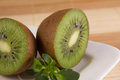 Two sliced kiwis close Royalty Free Stock Images
