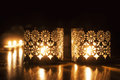 Two Small Burning Candles On D...
