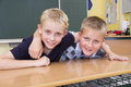 Two small friends in a yellow classroom Stock Image