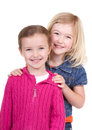Two small girls smiling on an isolated white background Stock Image